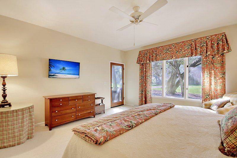 master bedroom with view and door out to deck