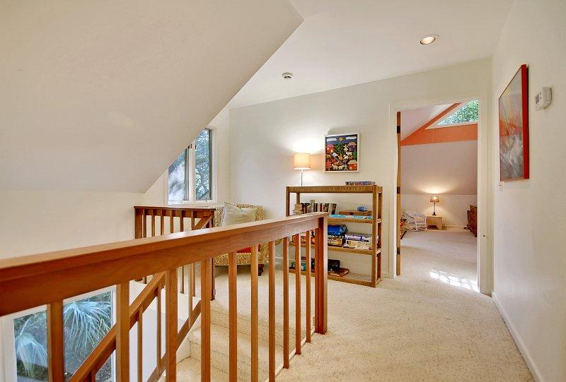 upstairs hallway with reading nook/looking from king bedroom toward queen/twins bedroom