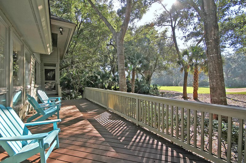 deck with ample seating and gas grill