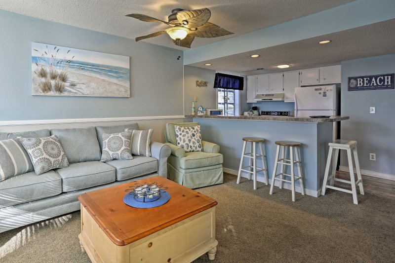 A cool, coastal theme is featured throughout this charming condo.