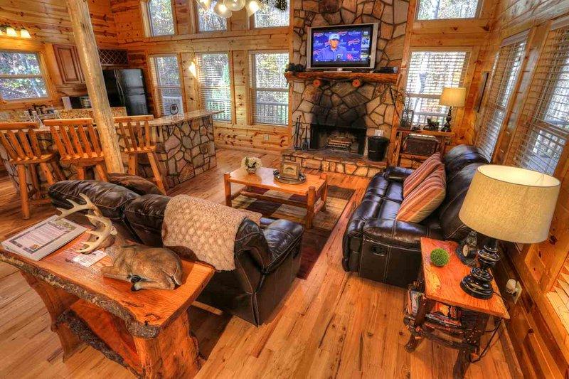 Mobiliário de couro e Grande TV HD