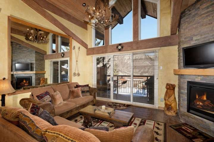 Great views, a gas fireplace, flat screen tv and a balcony with a gas grill make this living area a perfect place for your group to relax
