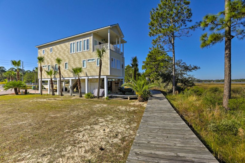 Situated on the Carrabelle River, this waterfront home offers a private dock, ideal for fishing or setting sail onto the open water.