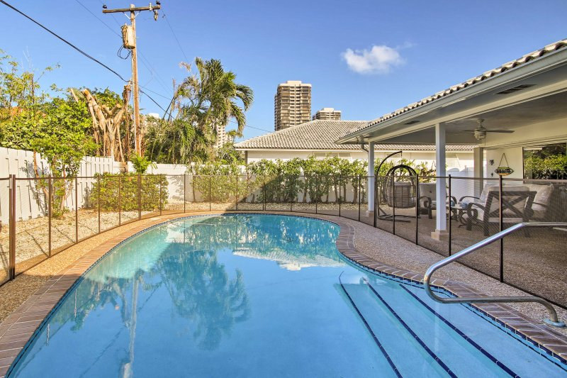 Soak up the sun when you stay at this vacation rental house in Riviera Beach!