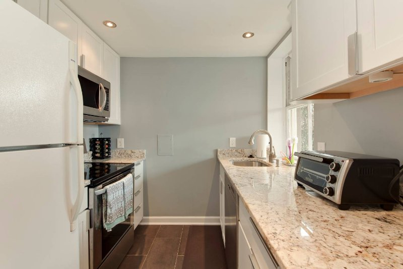 Great kitchen with coffee machine, ice maker, and pots and pans for cooking