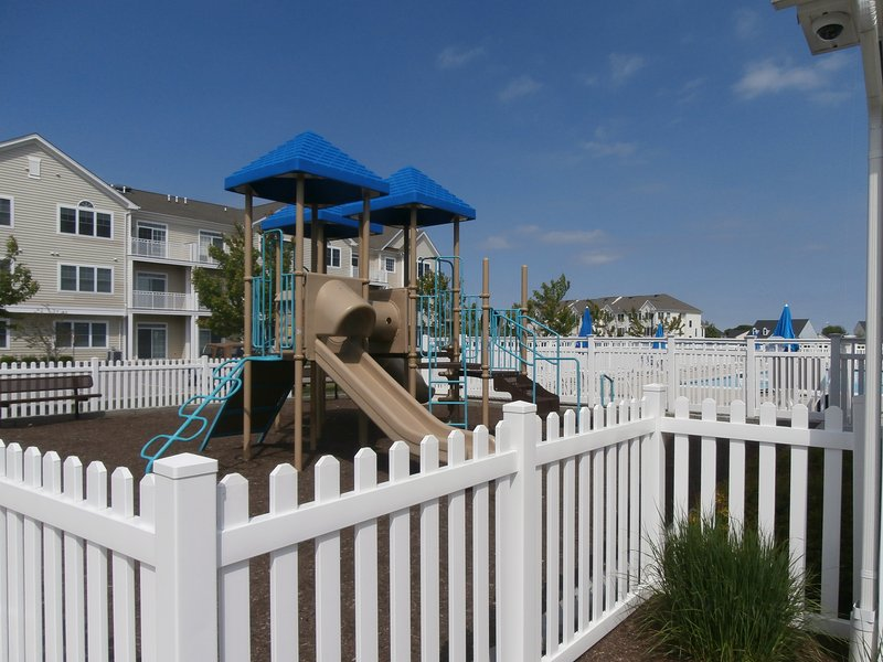 Community Playground well maintained and fenced in.  Close to pool!