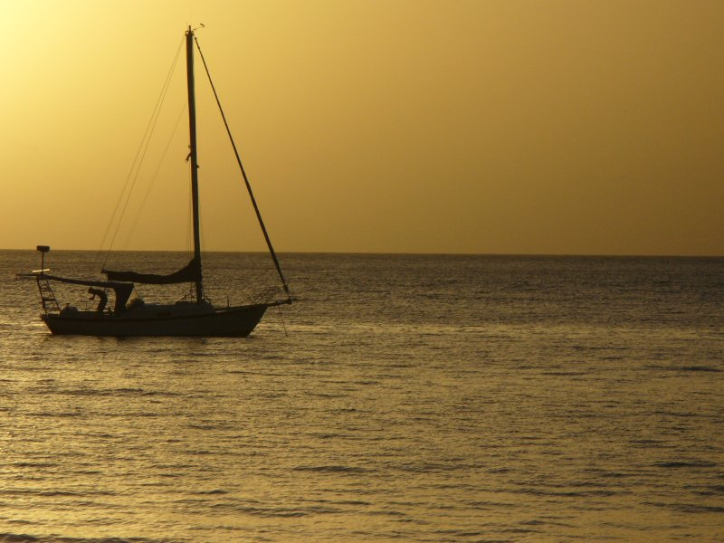 Sailing away into the sunset in Castara Bay