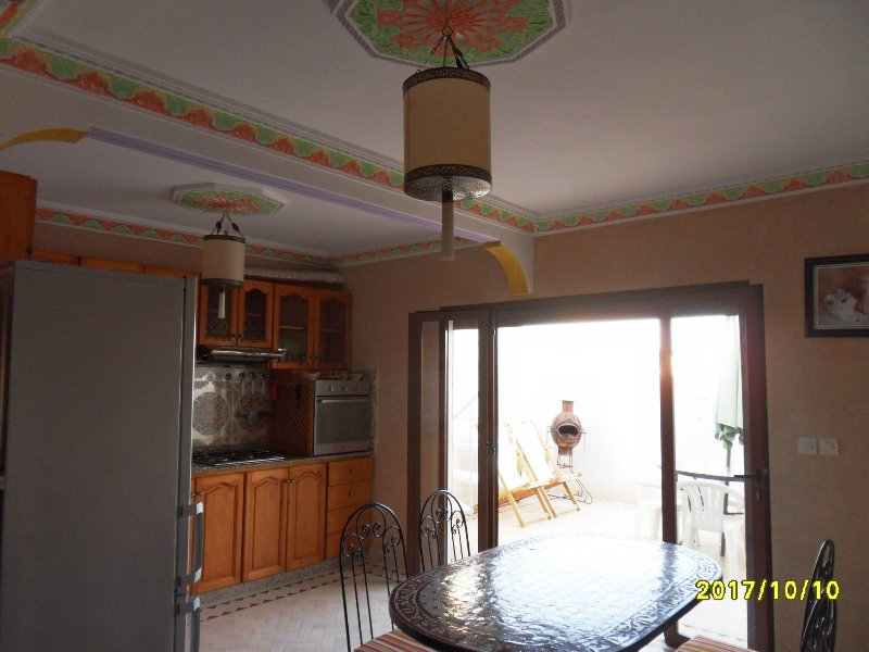 kitchen with its ceiling decorated terrace