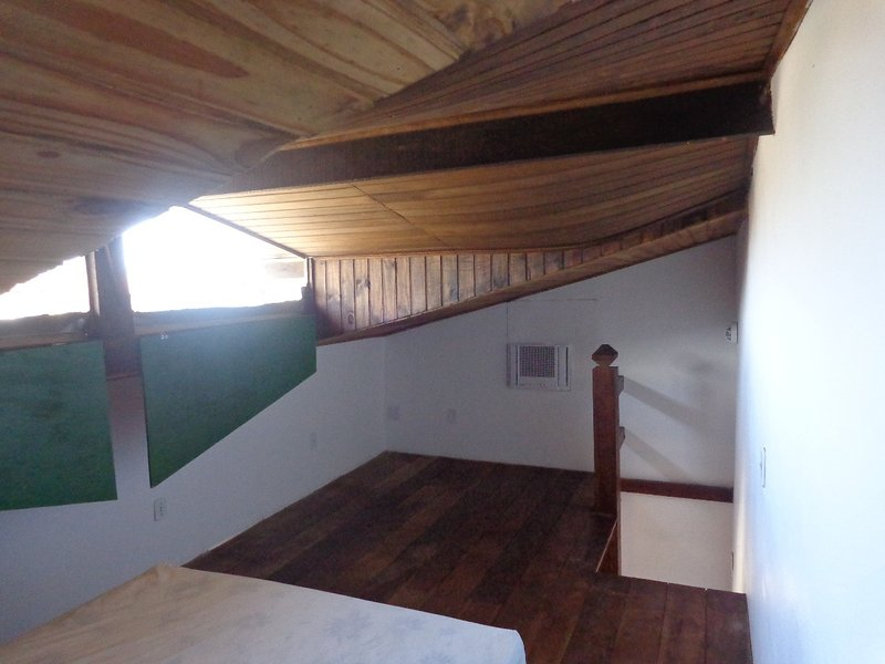 3 Bedroom house - a mezzanine above the living room with air conditioning.