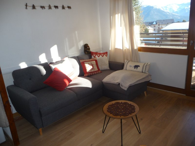Corner sofa convertible with mattress topper