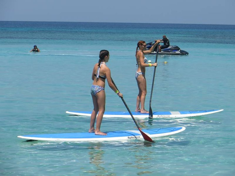 Paddleboarding West Bay Beach