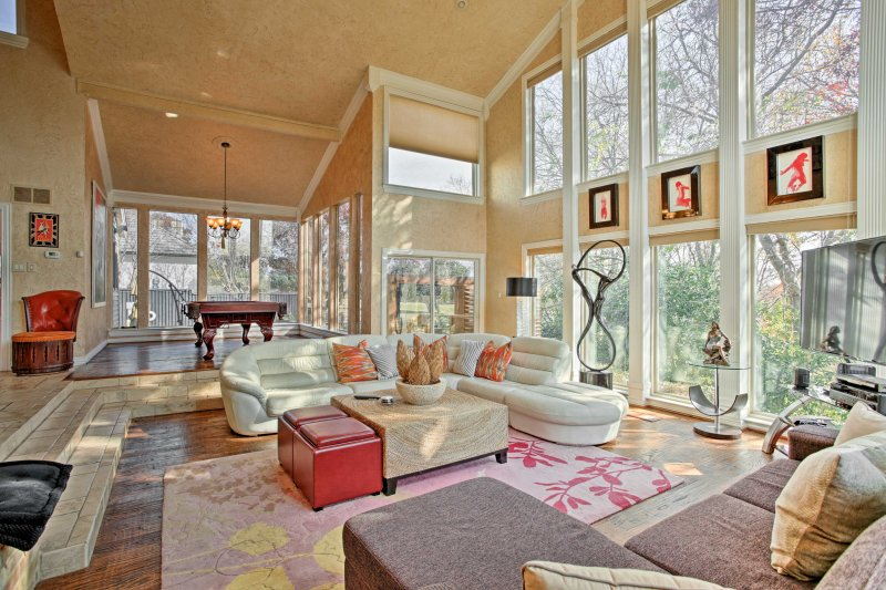 Numerous windows allow natural light to flood the open living area.