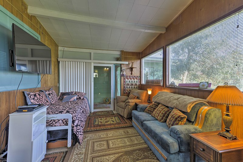 Your vacation begins the moment you walk into this light and airy abode.