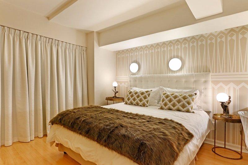 Art Deco Loft bedroom has a queen-size bed