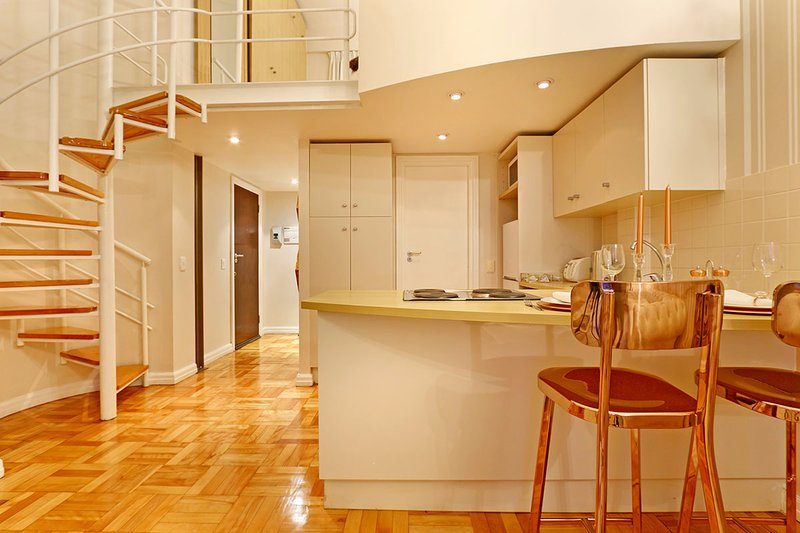 Art Deco Loft kitchen and spiral staircase to the loft