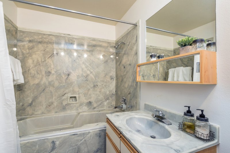 On the main living level there is a full bathroom with a combined shower and tub.