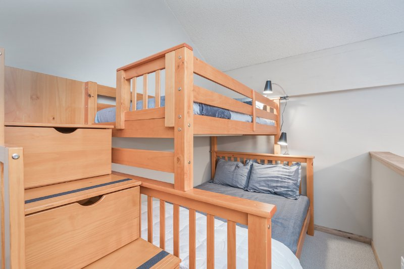 The Captain's Bunk has a full bed on the bottom and a twin bed on top.