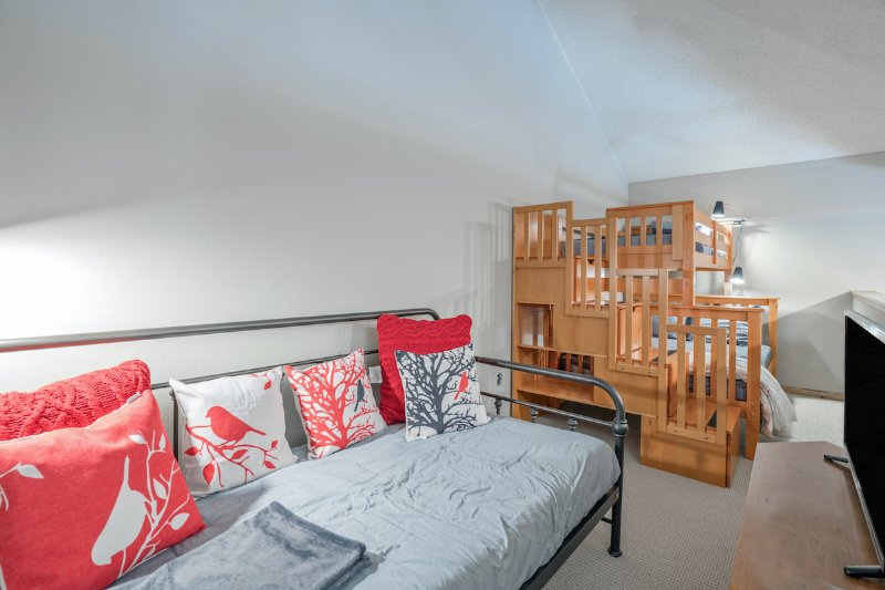 The spacious loft area is the perfect retreat for kids with a games console, day bed & bunk beds.