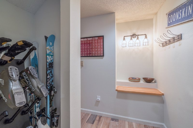 The downstairs entry to the condo features a boot drying rack & a bench seat for taking of ski boots!