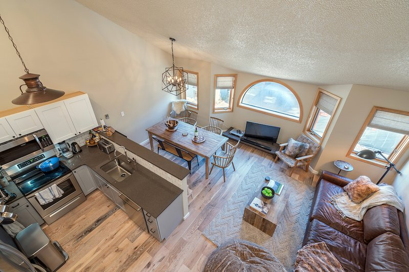 A bird's eye view of the living room from the spiral stairs leading up to the loft.