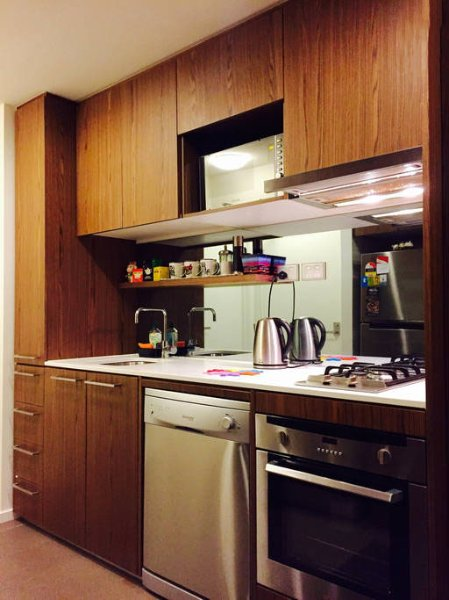 A remarkably functional kitchenette with all the essentials installed.