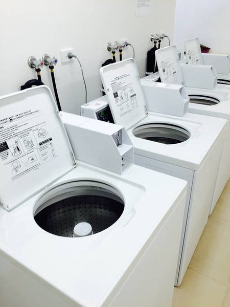 If you happened to have TONS of clothing need to be washed, there are washers available.