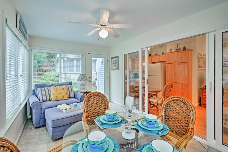 Enjoy a meal in the 3season sunroom while taking in wooded views.