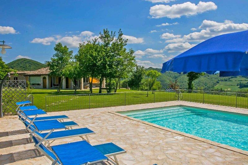 Pool area with sunbeds and sun umbrellas