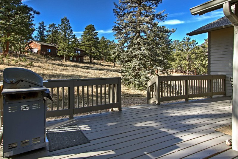Enjoy relaxing evenings on the back deck featuring panoramic mountain views.