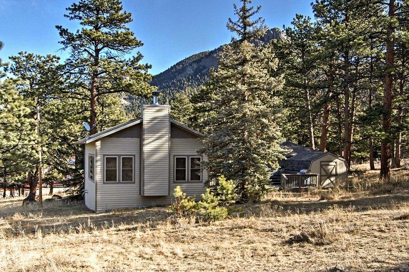 Mountain peaks surround this home.