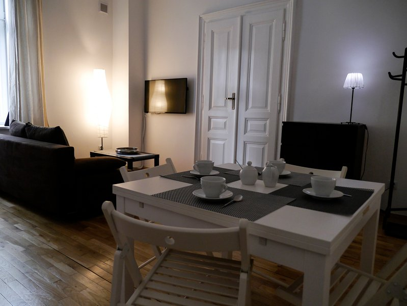 Specious apartment with a stylish decor. Large TV and a separated dinning area.