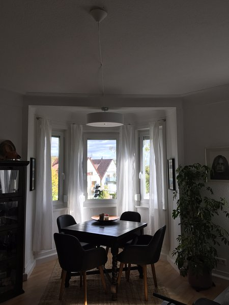 Bay window in the living room with dining area