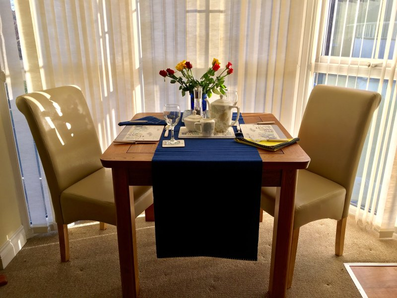 a sunny dining space, always flowers for your arrival