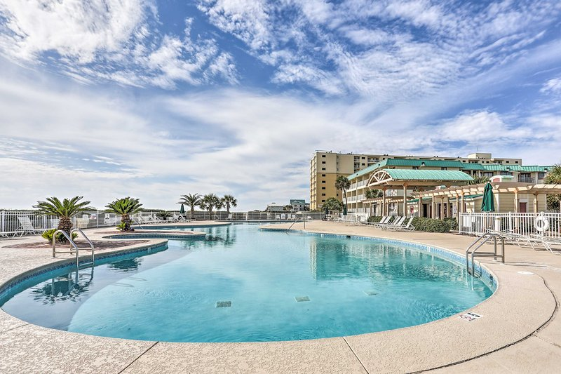 With access to community pool and the beach a few steps away, this 2-bedroom, 2-bathroom beachfront condo is the perfect place to spend your next Gulf Shores getaway!
