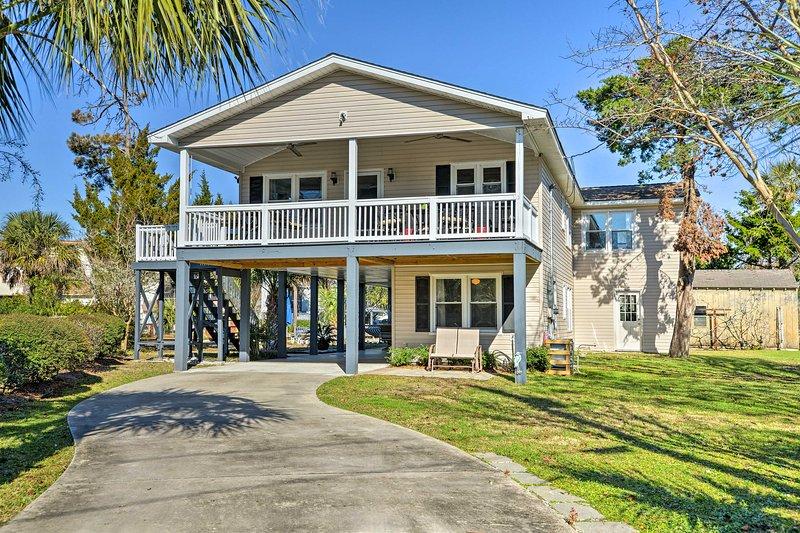A memorable coastal getaway awaits at this Surfside Beach vacation rental house!
