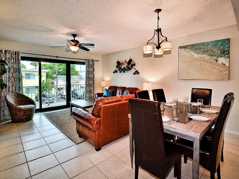 Spacious living and dining area with balcony access.