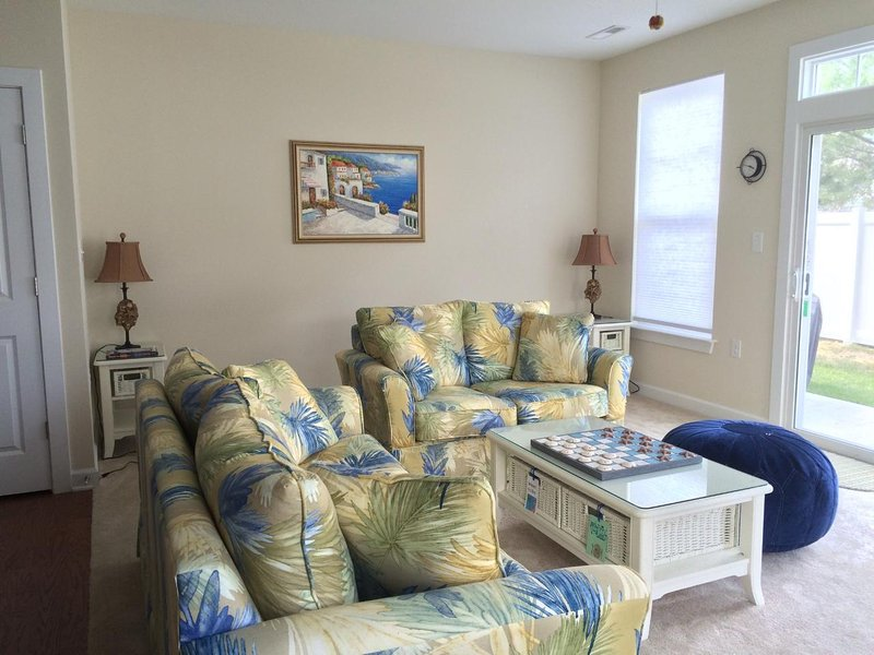 Welcome to Shoal Harbor!  Inviting Brand New End Unit Sleeping 8 People Living Room with French doors to the Patio.