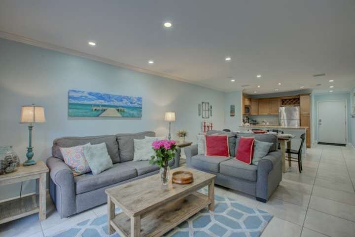Beautiful and cozy living room decorated with beach accents.  Large screen TV for your entertainment. Cable included.