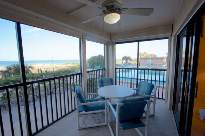 Enjoy a Family Meal or a Cocktail while watching the  Gorgeous Sunset on this large Gulfview Patio