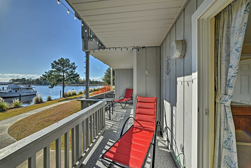 Relax on the balcony with a marina view at this condo in New Bern.
