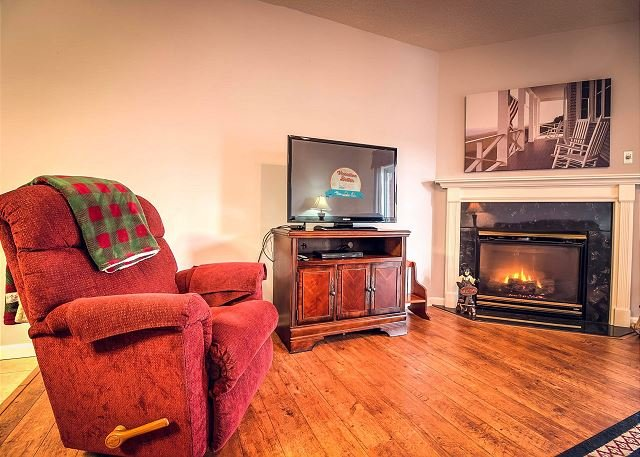 Gas Fireplace and 3 Recliners in Living Room