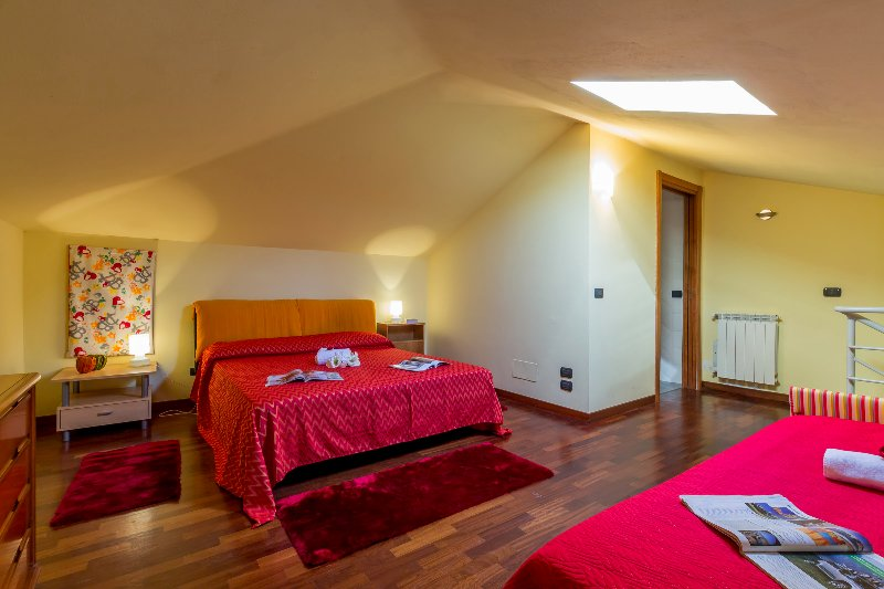 Bedroom on the mezzanine with a double bed and single bed