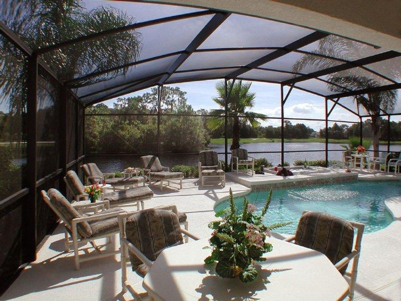 Large pool deck, lots of sun loungers, stunning lake view.