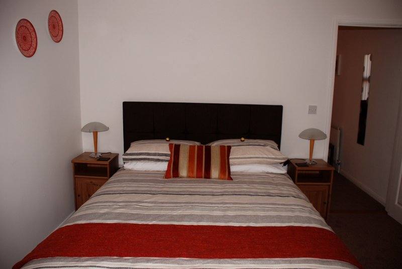 Master bedroom with King Size bed. The mattress is a pocket sprung orthopedic.