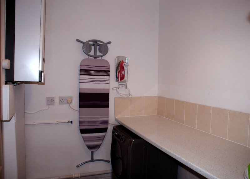The Utility room has a large washing machine and all you need including steam iron and ironing board