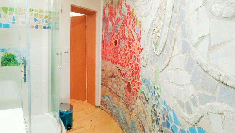 Bathroom with art tile mosaic wall