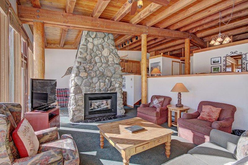 SkyRun Property - '2036 Homestead' - Living Room - Stone fireplace.