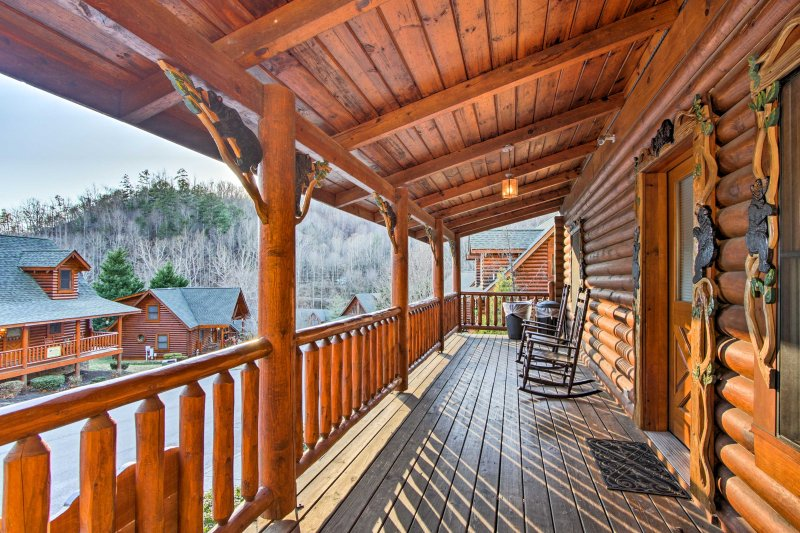 Relax on the porch during your stay at this  vacation rental cabin.