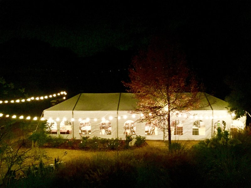 Event Tent at night all lit up under the stars.  Makes for magical moments.