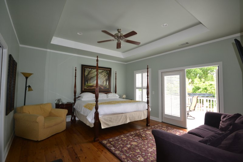 Dual Master Suite #2  opens to deck.  Private ensuite luxury bathroom . HDTV- Ceiling Fan. Sofabed.